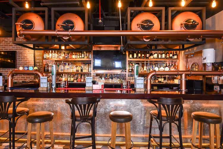 Seats at the bar in Mr Toads Pub in hotel near Dubai Silicon Oasis