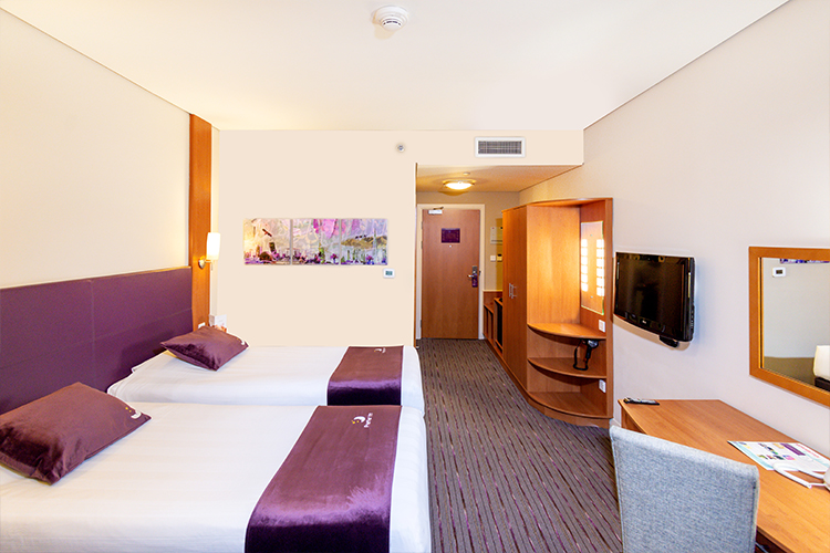 Two beds in a twin room at Premie rInn hotel in Abu Dhabi Capital Centre