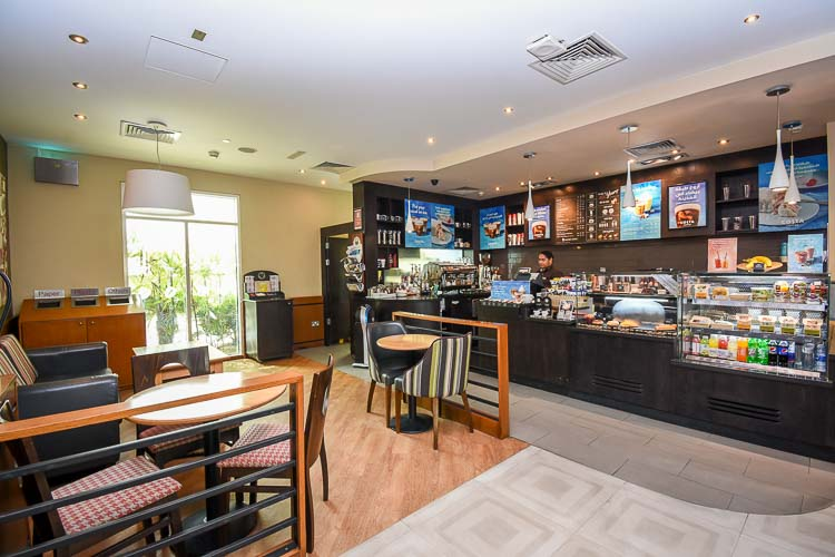 Costa Coffee shop with seating at Premier Inn Dubai Investments Park hotel