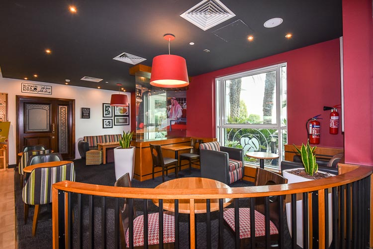 Seating area at Costa Coffee cafe shop in Premier Inn hotel near Expo 2020