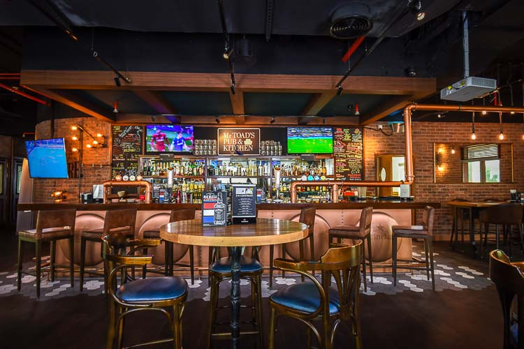 Mr Toad's Pub bar area with TV screens to watch sport at Premier Inn hotel