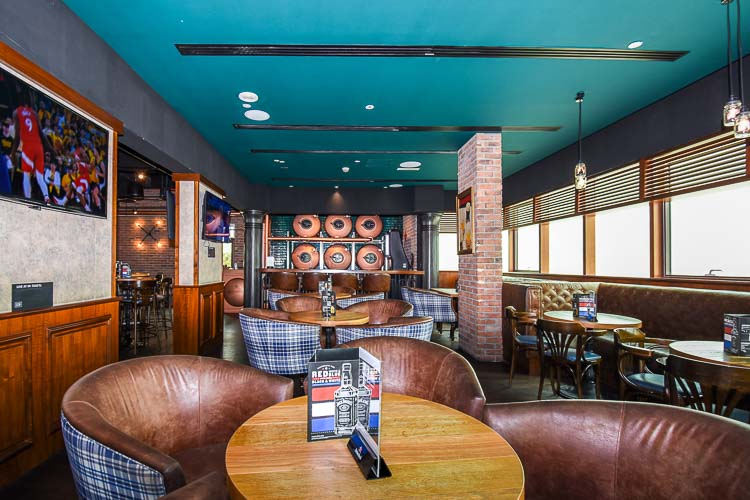 Confy seating in pub at Premier Inn Dubai Investments Park hotel