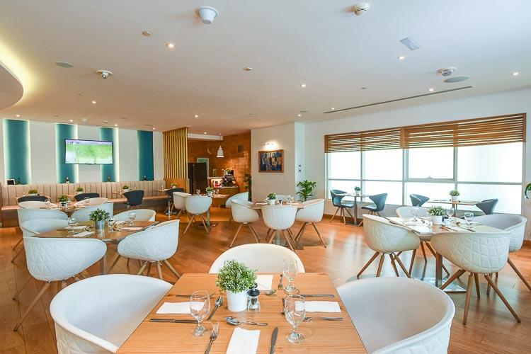 Restaurant seating area in Premier Inn Dubai Silicon Oasis hotel