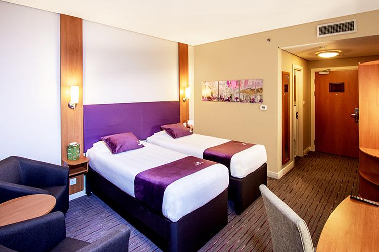 Twin bedroom at Premier Inn hotel in Abu Dhabi near ADNEC