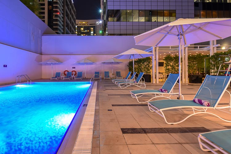 Swimming pool at night in budget hotel in Abu Dhabi Capital Centre