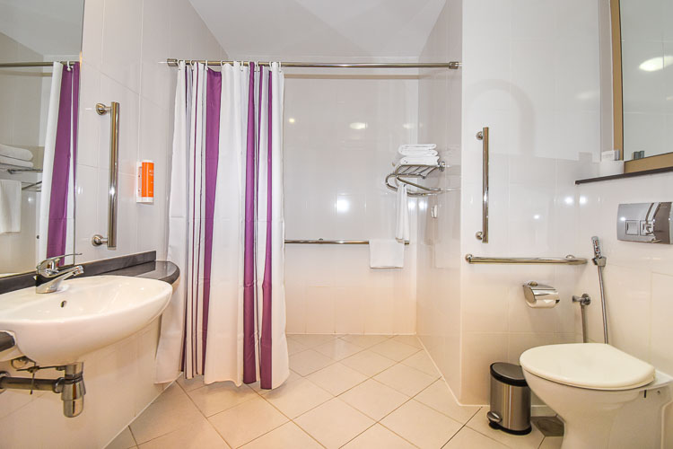 Accessible bathroom and wet room for guests staying at Premier Inn hotels in Abu Dhabi