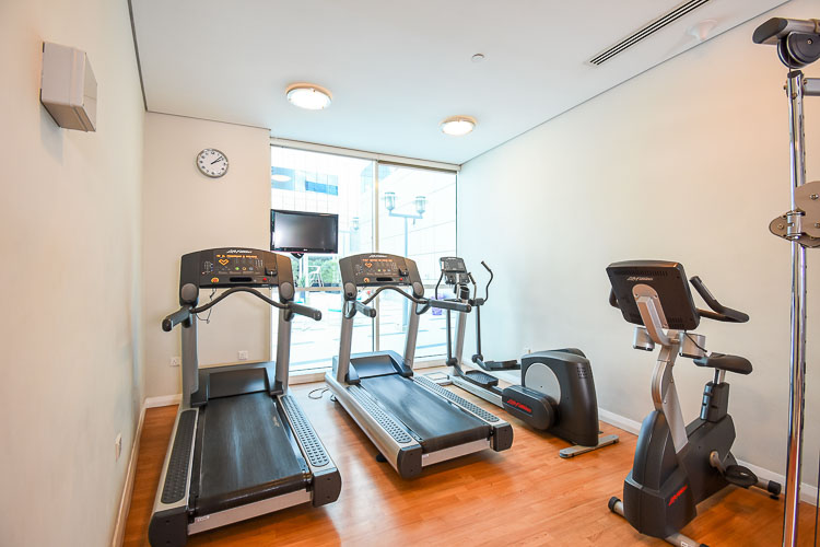 Gym with running machine at budget hotel in Abu Dhabi Capital Centre