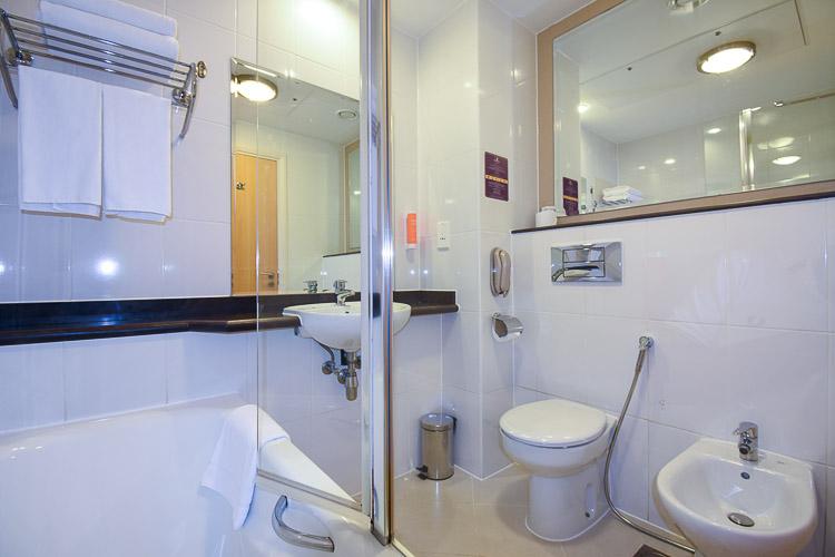 Ensuite bathroom in hotel room at Premier Inn Dubai Silicon Oasis hotel