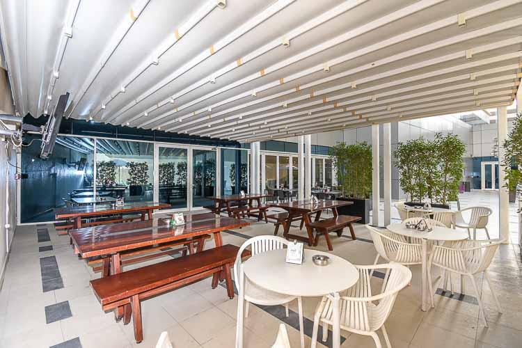 Outdoor seating at hotel restaurant in Premier Inn Abu Dhabi Capital Centre