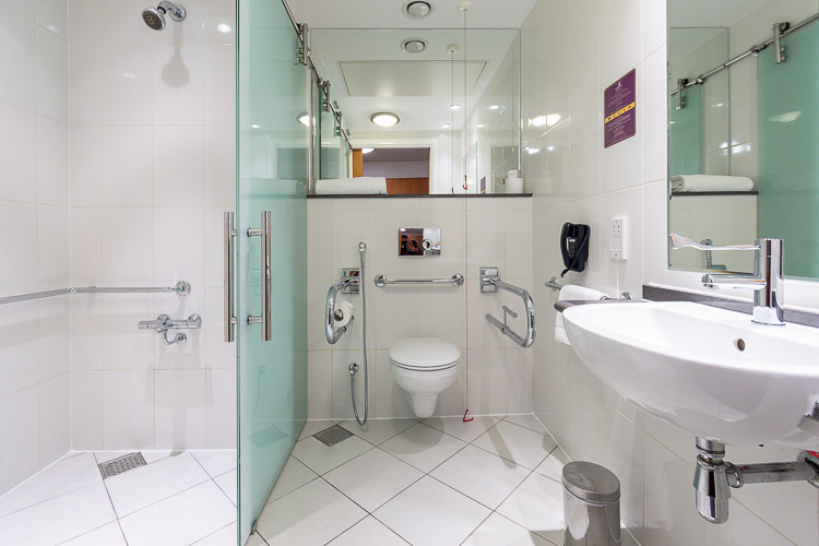 Accessible bathroom wet room for guests with special needs at Premier Inn Abu Dhabi International Airport hotel