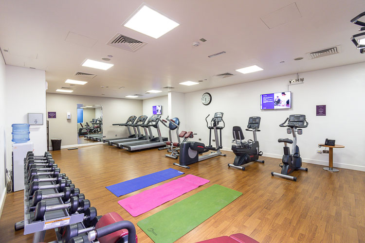Weights and yoga mats at the gym in Premier Inn Abu Dhabi International Airport hotel