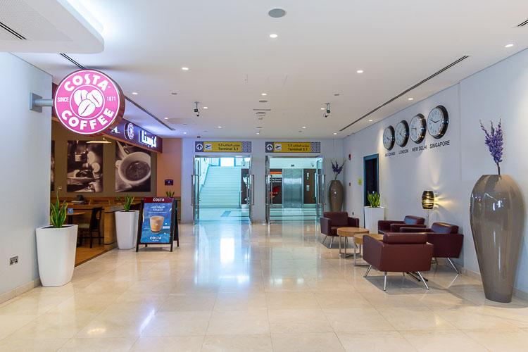 Entrance to Skypark Walk Abu Dhabi Airport with Costa Coffee at Premier Inn Abu Dhabi International Airport hotel