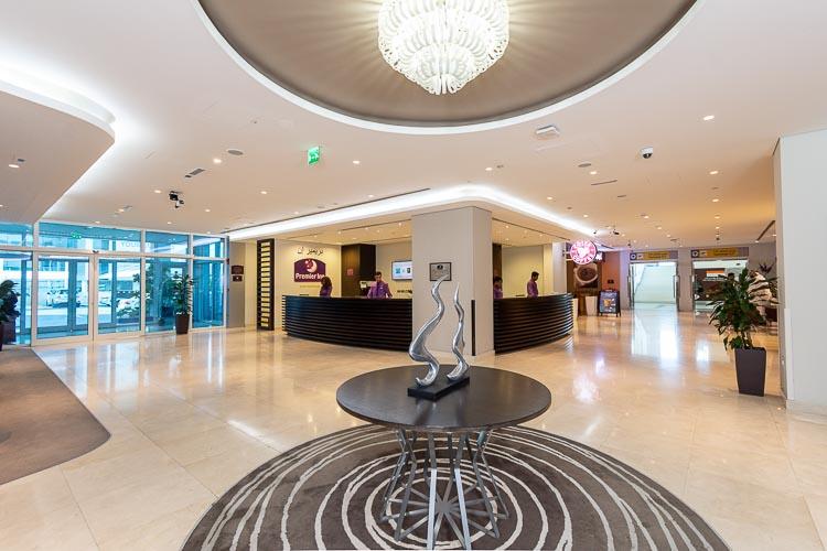 Lobby entrance and reception area at Premier Inn Abu Dhabi International Airport hotel