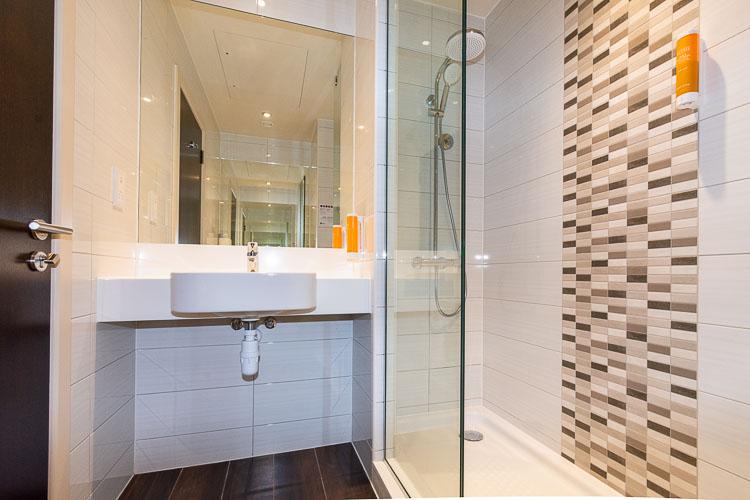 Shower in ensuite bathroom in Premier Inn Dubai Al Jaddaf hotel