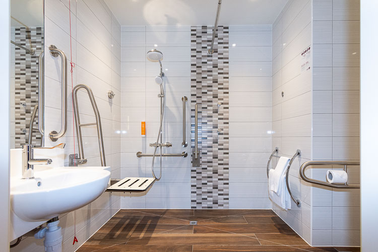 Accessible bathroom and wet room for guests with special needs in hotels in Dubai