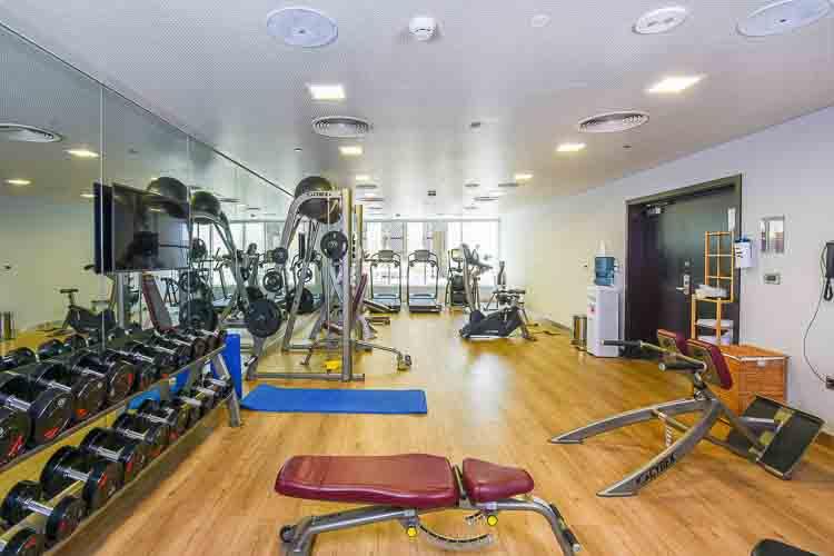 Gym with weights and machines at Premier Inn Dubai Al Jaddaf