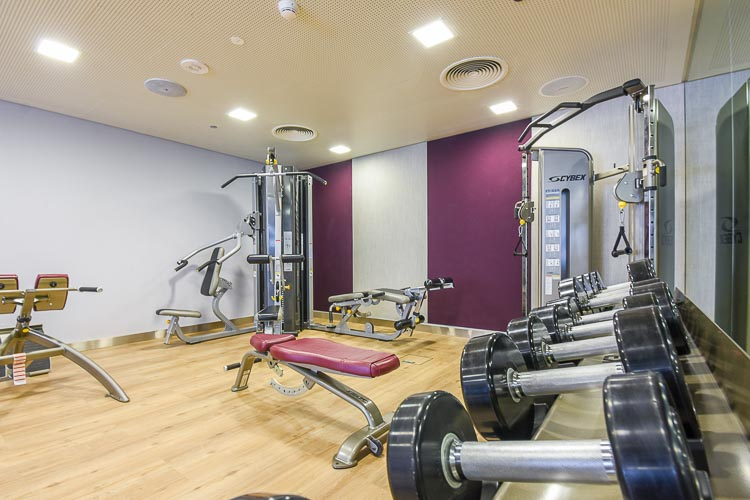 Large gym workout room in budget hotel Dubai