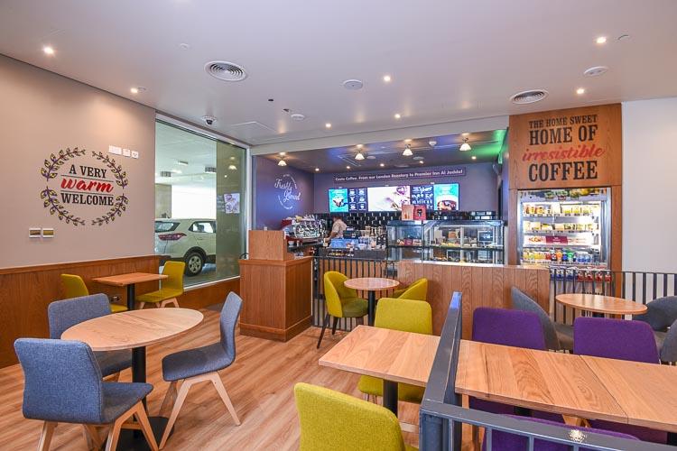 Seating area at Costa Coffee in Premier Inn Dubai Al Jaddaf hotel