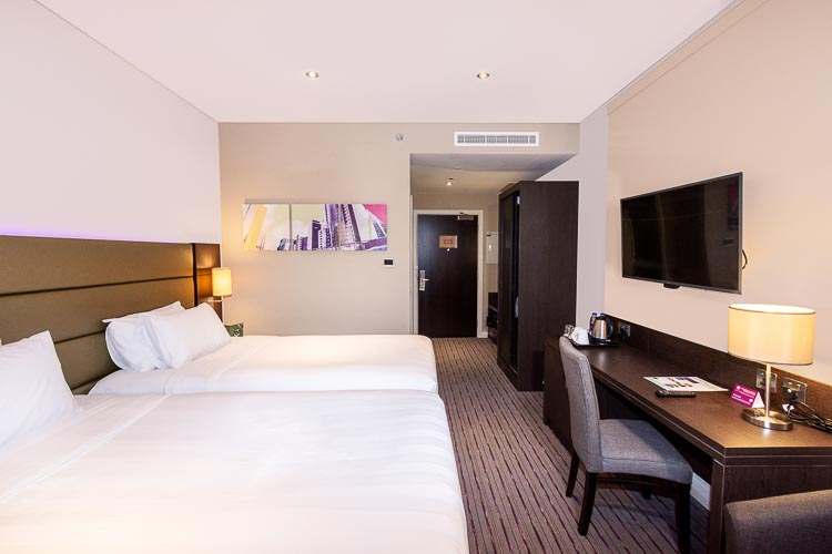 Two beds in Dubai hotel room at Premier Inn Dubai Al Jaddaf