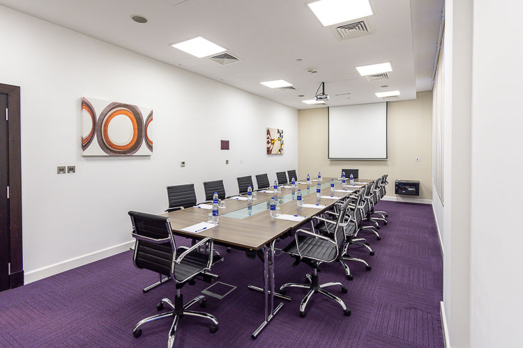Large meeting room set up for board room at hotel near Abu Dhabi Airport