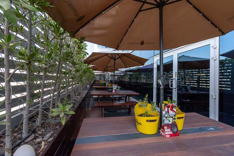 Outdoor garden seating at hotel near near Abu Dhabi airport