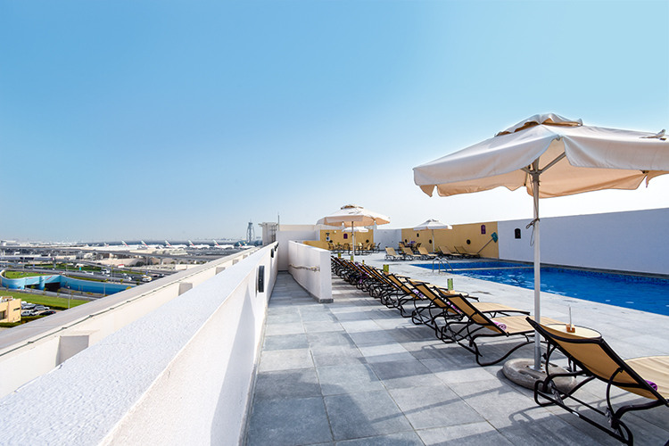 Views of Dubai International Airport from the rooftop swimmig pool and terrace at Premier Inn hotel