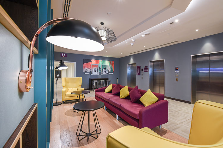 Colourful seating area in the lobby for guests with free wifi in Premier Inn Dubai Airport hotel