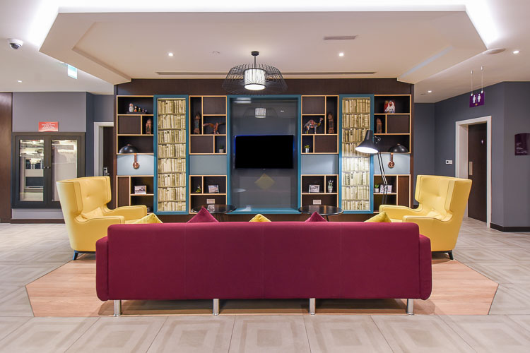 Sitting area for guests at Premier Inn Dubai International Airport with TV and free wifi access