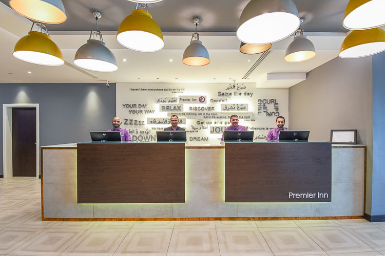 Lobby and reception desk at Premier Inn Dubai International Airport hotel with 24 hour reception access for guests