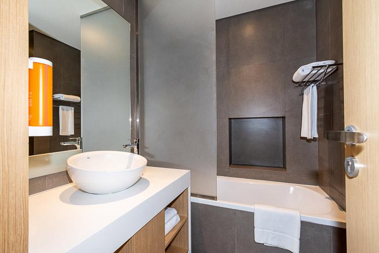 Bathroom with a bath tub and shower at Premier Inn hotel near Dragon Mart