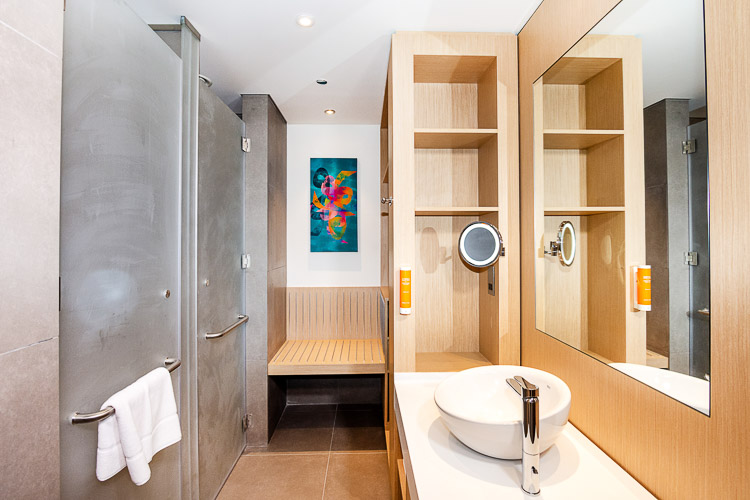 Ensuite bathroom with shower and dressing area in budget hotel in Dubai