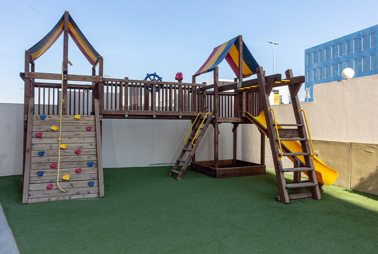 Play area with slide and climbing wall for children at Premier Inn hotel