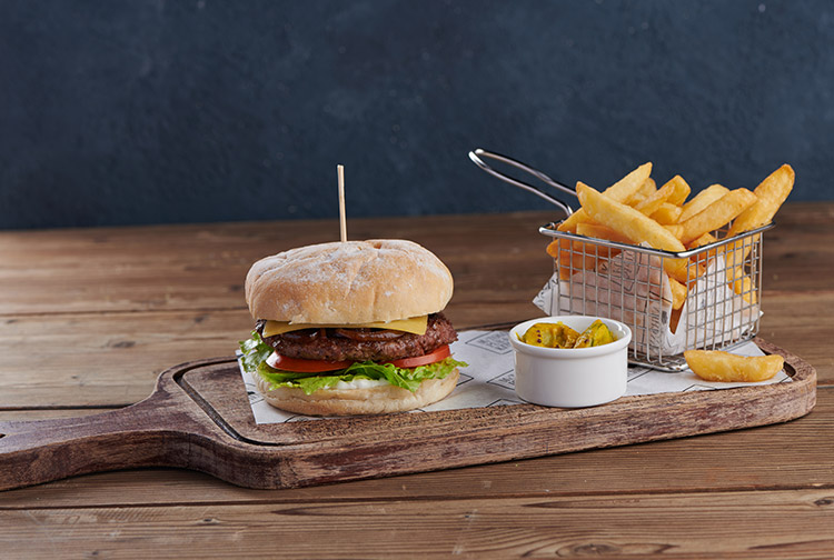 Beef burger with fries and sauce served at pub near Expo 2020