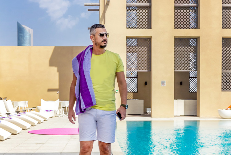 Tourist at the swimming pool in Prmeier Inn hotel in Dubai