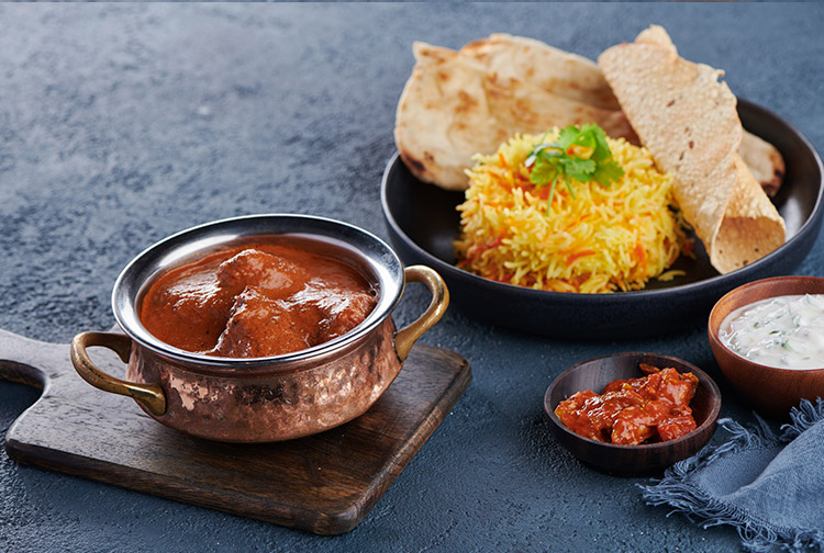 Indian curry and rice dish at restaurant in budget hotel in Dubai