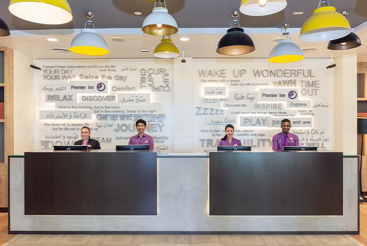 Premier Inn reception team welcoming guests at a hotel in Dubai Al Jaddaf
