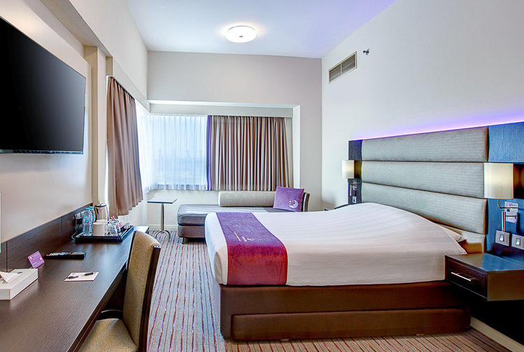 Double room with large bed and great views of Dubai at Premier Inn hotel