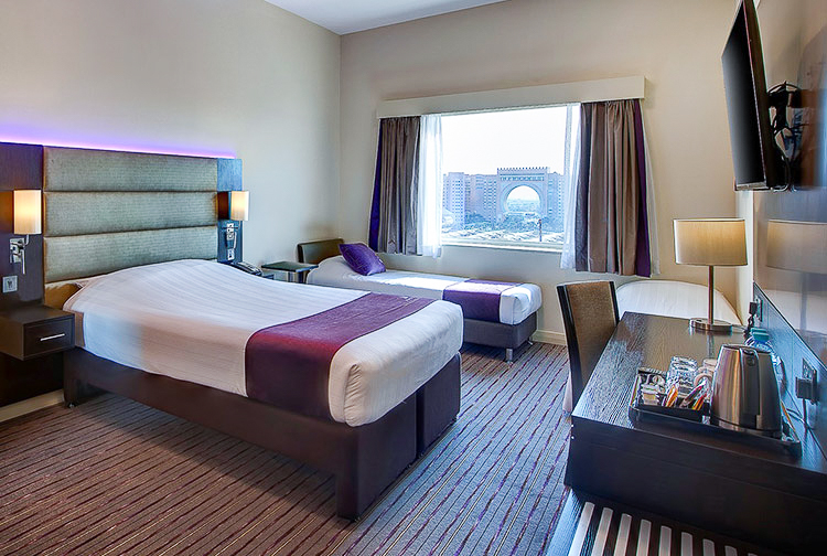 Family room with three beds and views of Ibn Battuta Gateat Premier Inn hotels