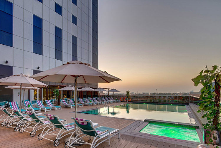 Sunset views from the swimming pool and jacuzzi at Premier Inn Ibn Battuta Mall hotel