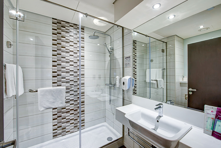 Private ensuite bathroom with large shower at Premier Inn hotels