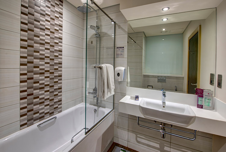 Private bathroom with bath and shower at Premier Inn Ibn Battuta Mall