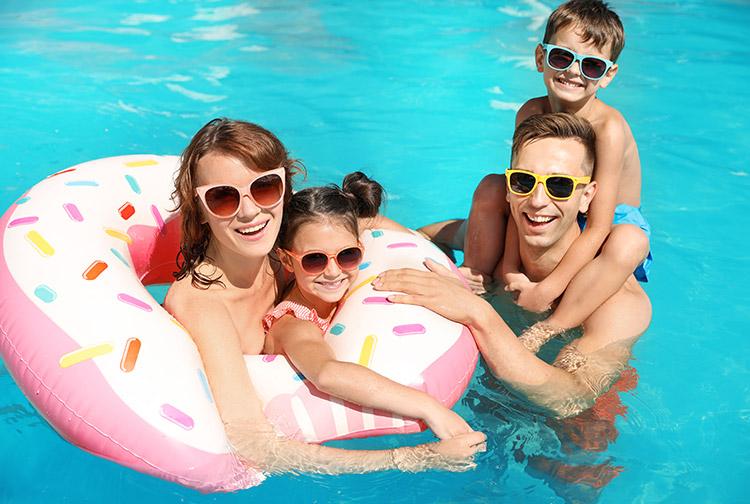 Family enjoying the swimming pool at Premier Inn hotels