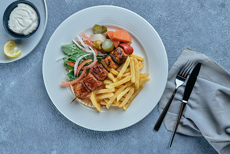 Shish Taouk served with fries at Nuevo family restaurant at Premier Inn Dubai Airport hotel