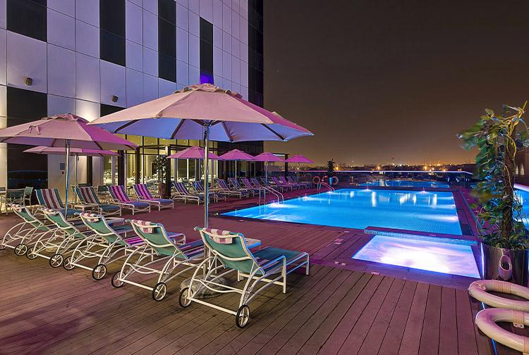 Swimming pool at night in Premier Inn Ibn Battuta Mall hotel