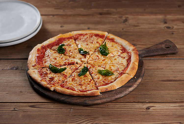 Margarita pizza topped with cheese served at Nuevo Restaurant at Premier Inn Dubai International Airport hotel