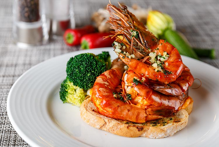Prawns served on toast with broccolli at Omnia restaurant in Premier Inn Doha Airport hotel