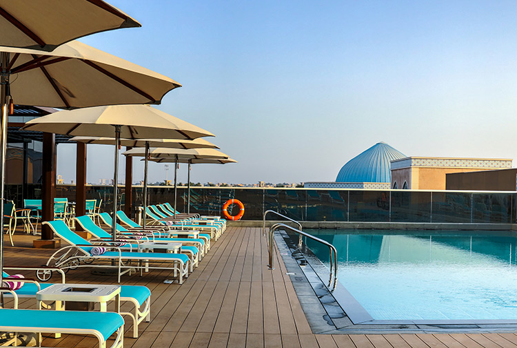 Swimming pool with free sun loungers and parasols at Premier Inn hotels