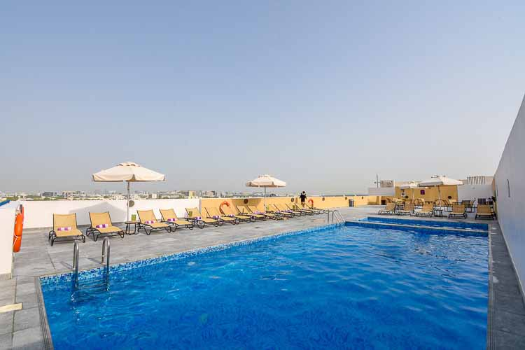 Rooftop swimming pool with airport views and free sunloungers at Premier Inn Dubai International Airport hotel