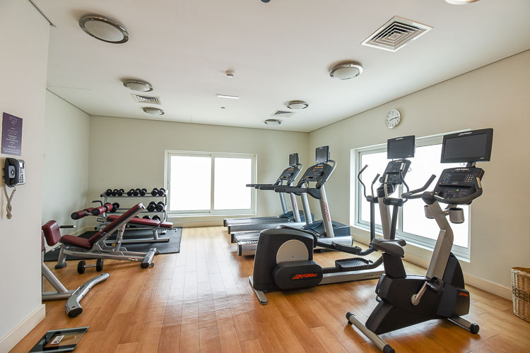 Exercise machines and free weights at the gym in Premier Inn Dubai International Airport hotel