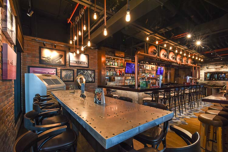 Inside Mr Toad's Pub and Kitchen with airprot-themed seating and decoration at Premier Inn Dubai Airport hotel